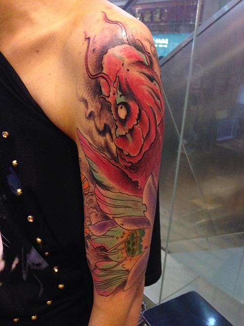手臂鱼纹身图片