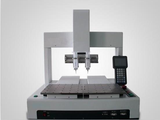 Three axis dispensing machine