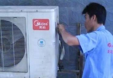 大冶美的空调移机