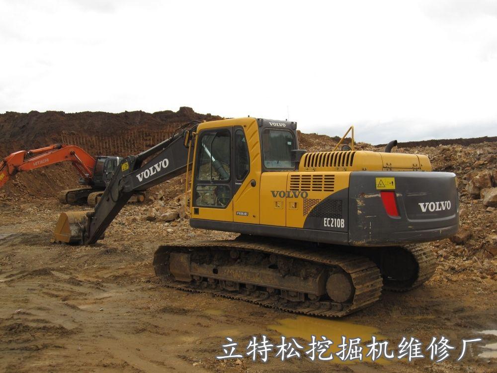 沃尔沃210挖掘机大臂上升动作慢原因与处理办法